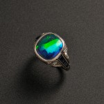 Art Deco Platinum, Black Opal, Sapphire, and Diamond Ring, Tiffany   & Co. (Lot 551, Estimate $3,000-$5,000)