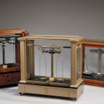 Three Analytical Balance Scales, a Wm. Ainsworth & Sons, a Voland & Son, New   Rochelle, N.Y. and Griffin (lot 700, Estimate $400-$700)