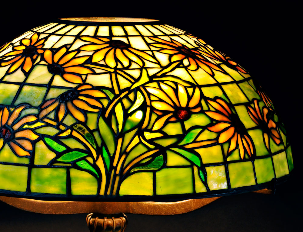 [Detail] Tiffany Studios Black-eyed Susan Mosaic Glass Table Lamp, Art glass and   patinated bronze, New York, early 20th century (Lot 46, Sold for $30,000)