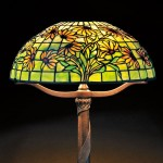 Tiffany Studios Black-eyed Susan Mosaic Glass Table Lamp, Art glass and   patinated bronze, New York, early 20th century (Lot 46, Sold for $30,000)