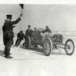 View of William Wallace and passenger in Fiat car no. 25 at starting line during the 1905 Ormond-Daytona races in Florida. Courtesy of the National Automotive History Collection, Detroit Public Library