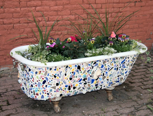 Pottery shards adhered to an upcycled bathtub