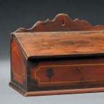 Red-painted Decorated Slant-Lid Wall Box, reportedly came from Pennsylvania,   19th century (Lot 1042, Estimate $400-$600)