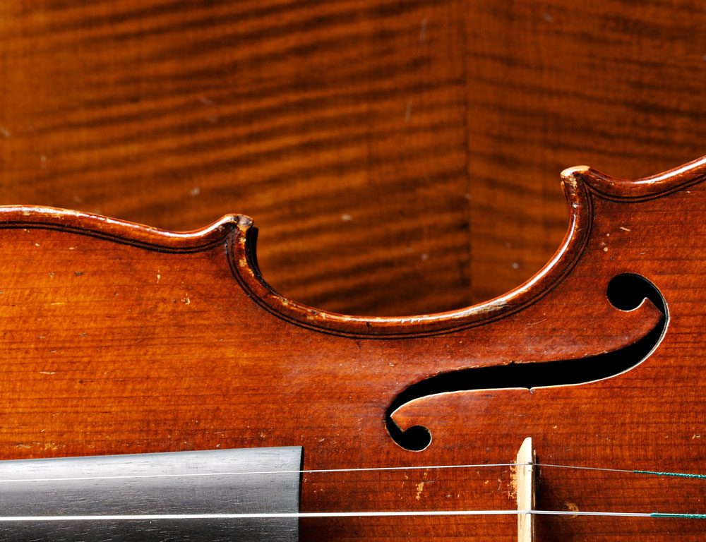 Calvin Baker Violin and Back of a John Juzek Cello