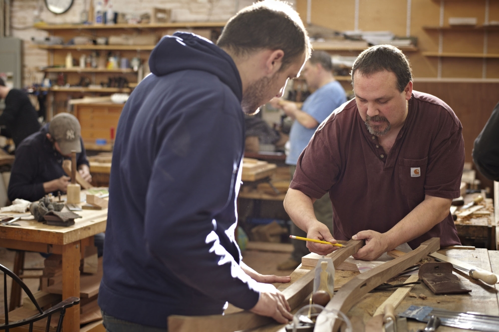 Furniture student working with instructor Steve Brown (photo by Heather McGrath)