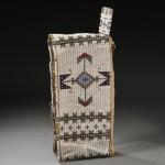 Lakota Beaded Hide and Cloth Cradle, c. 1880s (Lot 118, Estimate $2,000-  $2,500)