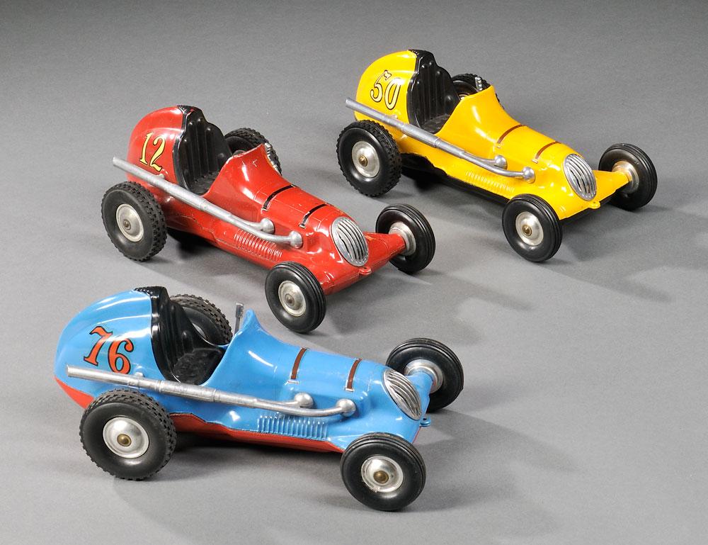 Three Roy Cox Thimble Drome Champion Die-cast Race Cars, c. 1950 (Lot 1110, Estimate $300-$500)