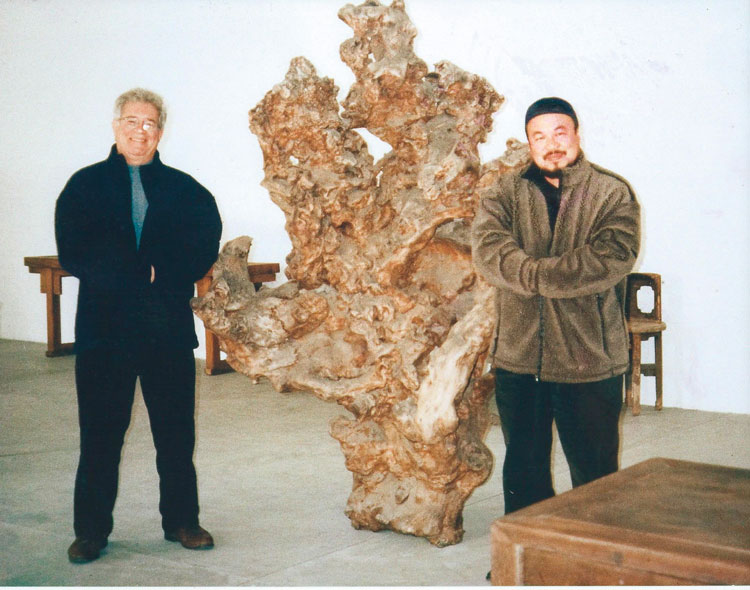 Peter L. Rosenberg and Ai Wei Wei with a massive root sculpture (Lot 540, Estimate $2,000-$3,000). Photo Courtesy of the Rosenberg Family