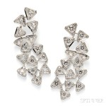 18kt White Gold and Diamond 'Puzzle' Earpendants, Cartier, France (Lot 718, Estimate $30,000-$40,000)