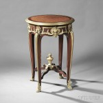 Louis XVI-style Ormolu-mounted Mahogany and Parquetry Occasional Table, France, late 19th/early 20th century (Lot 388, Estimate $2,000-$4,000)