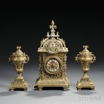 French Renaissance Revival Brass Clock and Garniture Set, late 19th century (Lot 1328, Estimate $700-$900)